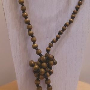 Wooden beads on leather cord